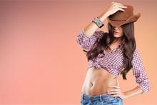 Portrait Of A Beautiful Woman Wearing  Cowboy's Hat