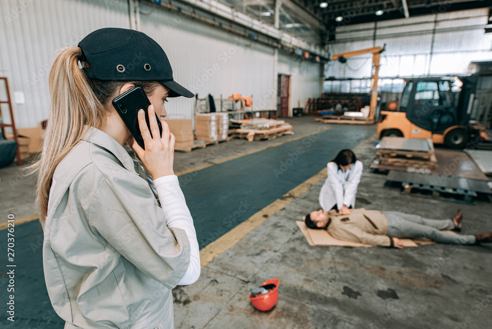 Fototapety, obrazy: Accident at work in heavy industry warehouse.