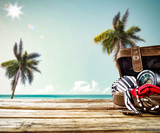 Wooden desk space and summer background of palms