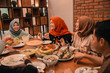 Family together in the dining room, a moments together with family before breaking their fast