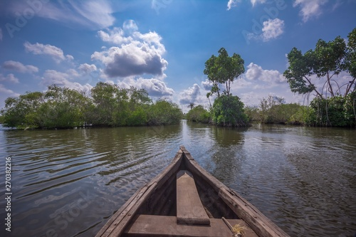 Photo Stands Lake Clouds and sky in Munroe Island, Ideal place for canoe trip through backwater canals