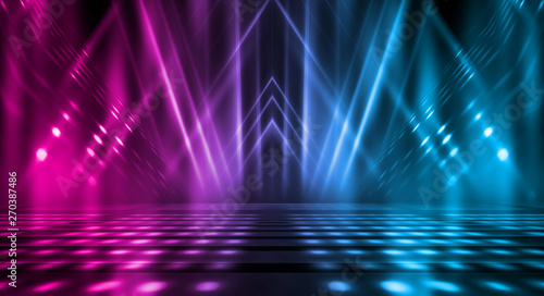 Fototapeta Background of empty stage show. Neon blue and purple light and laser show. Laser futuristic shapes on a dark background. Abstract dark background with neon glow obraz na płótnie