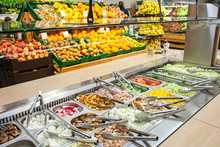 Salad Bar On Background Of Shop-windows With Vegetables And Fruits In Supermarket.