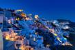 Oia village in Santorini island at sunset in Greece