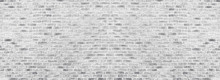 Wide White Washed Brick Wall Texture. Rough Light Gray Brickwork. Whitewashed Panoramic Vintage Background