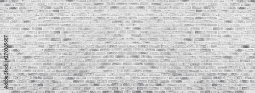 Spoed Fotobehang Baksteen muur Wide white washed brick wall texture. Rough light gray brickwork. Whitewashed panoramic vintage background