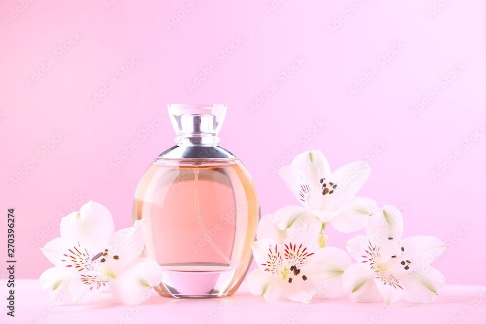 Fototapety, obrazy: Bottle of perfume with flowers on pink background