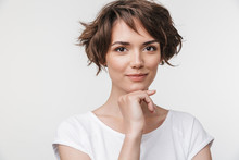 Portrait Of Cute Woman With Short Brown Hair In Basic T-shirt Looking At Camera