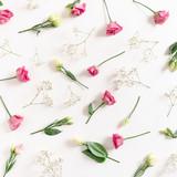 Pattern made of eustoma and gypsophila flowers on white background