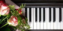 Bouquet Of Flowers On The Keys Of The Piano. Music Romantic Composition Flat Lay Top View Musical Background Long Banner