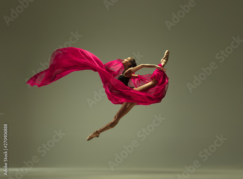 Spoed Foto op Canvas Dance School Graceful ballet dancer or classic ballerina dancing isolated on grey studio background. Woman with the pink silk cloth. The dance, grace, artist, contemporary, movement, action and motion concept.