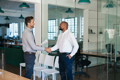 Photo Manager shaking hands with a job applicant after an interview
