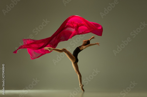 Naklejki taniec graceful-ballet-dancer-or-classic-ballerina-dancing-isolated-on-grey-studio-background-woman-with-the-pink-silk-cloth-the-dance-grace-artist-contemporary-movement-action-motion-concept