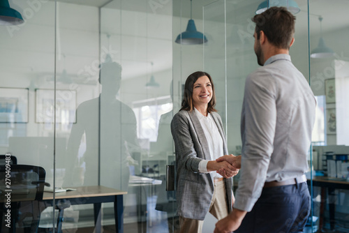 Photo Manager smiling while welcoming a new office employee