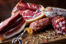 Traditional Sausage , Sausage With Mold And Spanish Ham( Bellota, Jamon). Sliced Sausage Salami On Wooden Board With Spices: Pepper And Fennel. Close-up.
