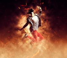 Man Break Dancing On Fire Background