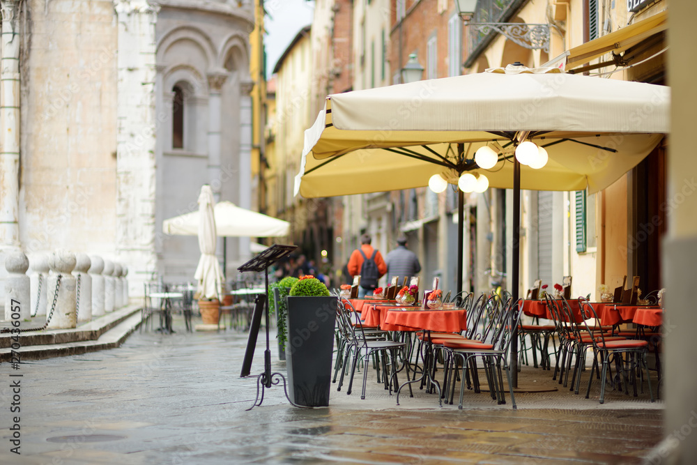 Fototapety, obrazy: Beautifully decorated small outdoor restaurant tables in the city of Lucca, Italy