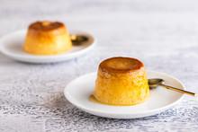 Flan Dessert On The Plate .Popular Crème Caramel Dessert Background With Copy Space...