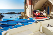 Colourful Boats In Tiny Marina Of Riomaggiore, The Largest Of The Five Centuries-old Villages Of Cinque Terre, Italian Riviera, Liguria, Italy.