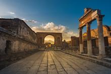 Ruins Of Ancient City Of Pompeii, Ancient Roman City Against Vesuvius Volcano At Sunset, Italy. Street In Pompeii