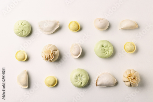 Photo  Composition with different dumplings on white background, top view