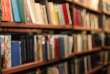 Blurred View Of Shelves With B...