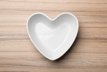 Heart Shaped Plate On Wooden B...