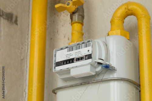Fotografía Residential natural gas meter on indoor wall to measure household energy consump