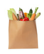 Paper bag with vegetables on white background
