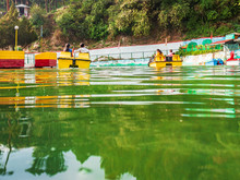 People Enjoying Pedaled Boat Ride Surrounded By Scenic Beauty In The Man-made Lake  On Way To The Hill Station Mussoorie- Image