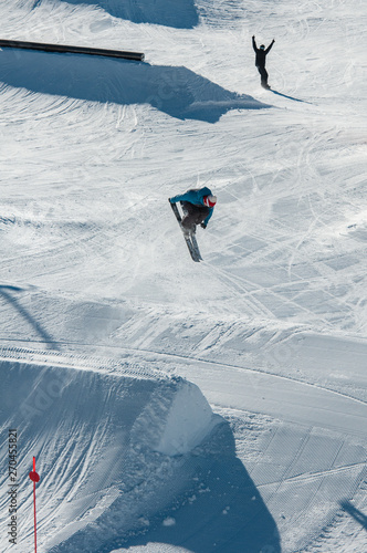 A skier hitting his jump off the kicker in the snowpark Tapéta, Fotótapéta