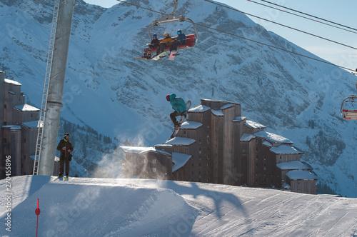 Fényképezés A snowboarder hitting his jump off the kicker in the snowpark