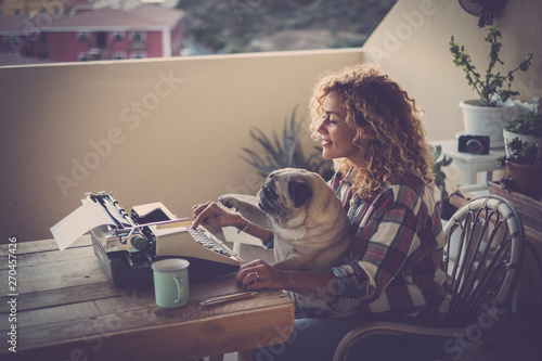 Blogger lifestyle concept with pretty curly blonde adult woman write on old type Tableau sur Toile