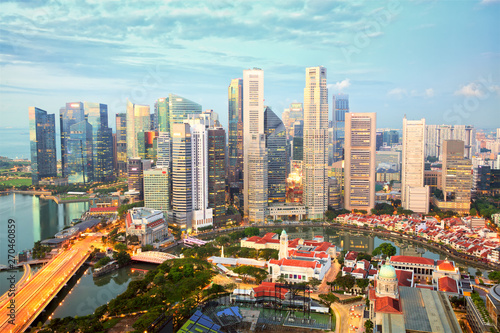 Photo  Singapore city skyline and financial business district at sunset