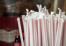 A Bunch Of Wrapped Red Straws