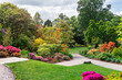 Leinwanddruck Bild - Beautiful Garden with blooming trees during spring time, Wales, UK
