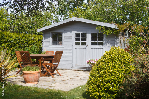 Papiers peints Jardin Shed with terrace and wooden garden furniture in a garden during spring