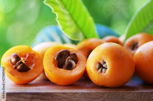 Fotografiet Loquat Medlar fruit isolated on a green background