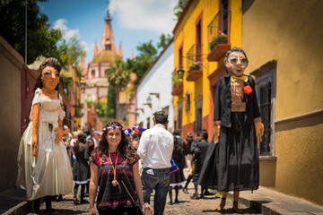 Woman in the Beautifull town of San Miguel de Allende celebrating a wedding with mojigangas in a callejoneada