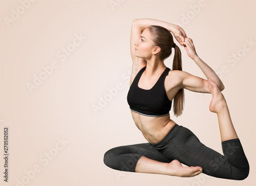 Obraz na plátně  Young beautiful woman doing Yoga on white background