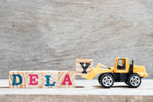 Toy Bulldozer Hold Letter Block Y To Complete Word Delay On Wood Background
