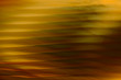 Abstract blurred background.Gold lines and curves. Striped pattern.