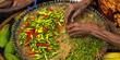 Leinwanddruck Bild Hand checking dried chili pepper in a bamboo Basket