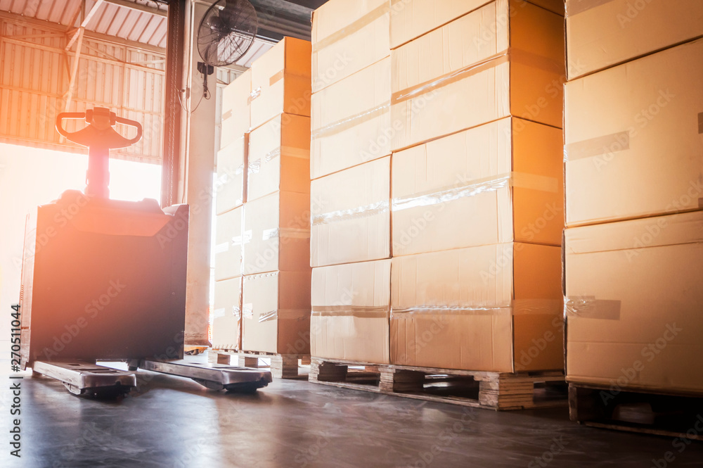 Fototapety, obrazy: electric forklift with stack of cardboard boxes in distribution warehouse.
