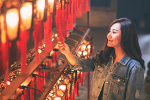 A Beautiful Asian Woman Enjoyed Looking At Red Lamps And Wishes In Chinese TempleA Beautiful Asian Woman Enjoyed Looking At Red Lamps And Wishes In Chinese Temple
