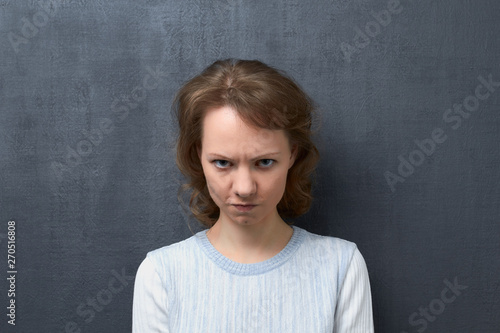Portrait of angry girl with frowning face Tablou Canvas