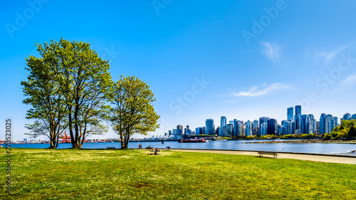 View of the Vancouver Skyline and Harbor. Viewed from the Stanley Park Seawall pathway in beautiful British Columbia, Canada