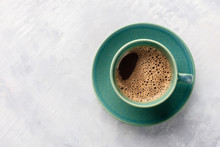 A Cup Of Black Coffee, Shot From The Top On An Abstract Gray Background With Copyspace