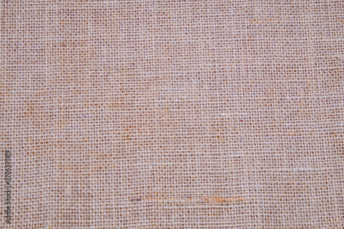 Hessian sackcloth burlap woven texture background / cotton woven fabric background with flecks of varying colors of beige and brown Fototapet