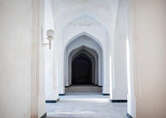 White Arabian arches in Kalyan Mosque that was built 16th-century. Bukhara, Uzbekistan. Central Asia.